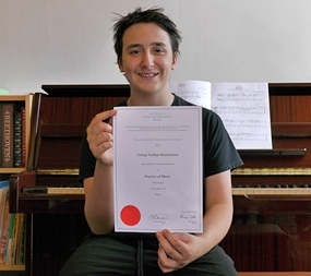 George Bournoxtsis, piano student, Melbourne, with his AMEB certificate