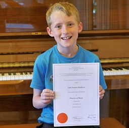 Luke Mathews, piano student, Melbourne, with his AMEB certificate